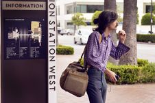 Free Person Wearing Purple Dress Shirt And Black Pants White Carrying Brown Sling Bag Stock Images - 109908374