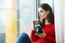 Free Woman Wearing Red Knitted Shirt Holding Instant Camera Royalty Free Stock Images - 109908529