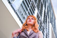 Free Woman In Grey Blazer Low Angle Photography Near Building Stock Images - 109908584
