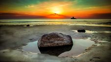 Free Stone Beside Seashore At Sunset Stock Photo - 109908670