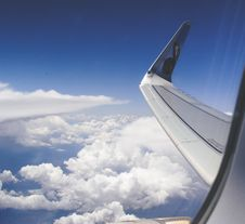 Free High-angle Photograph Of Airplane Wings Above The Clouds Under Clear Blue Sky Stock Photography - 109908962