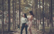 Free Two Woman Standing On Sidewalk Near Trees Royalty Free Stock Image - 109909096