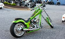 Free Green Naked Chopper Motorcycle On Parking Lot Stock Images - 109909114