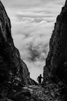 Free Silhouette Of Man Walking Between Two Cliff Royalty Free Stock Image - 109909196