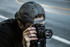 Free Man Taking Photo Using Black Canon DSLR Camera Stock Images - 109909314