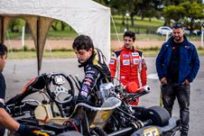 Free Two Motorcycle Racers Standing In Front Of Motorcycles Stock Photos - 109909343