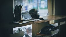 Free Gray Laptop Near Black Full-face Helmet Royalty Free Stock Image - 109909396