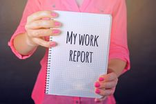 Free Woman In Pink Long-sleeved Shirt Holding White Book With My Work Report Text Print Stock Photography - 109909702