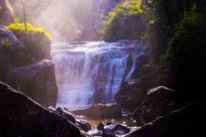 Free Waterfalls Surrounded By Grass And Rocks Stock Images - 109909744