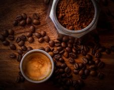 Free White Ceramic Mug Filled With Coffee Beside Coffee Beans Stock Photos - 109909753