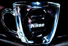 Free Close Up Photo Of Clear Glass Mug With Nikon Lens Cap Royalty Free Stock Images - 109909819