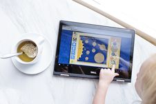 Free Kid Using Black Dell Tablet With Tea Royalty Free Stock Images - 109909839