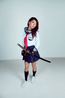 Free Woman Wearing School Uniform Samurai Outlook Carrying Katana Royalty Free Stock Photos - 109909908