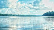 Free Calm Lake Under Cloudy Sky Royalty Free Stock Images - 109909949