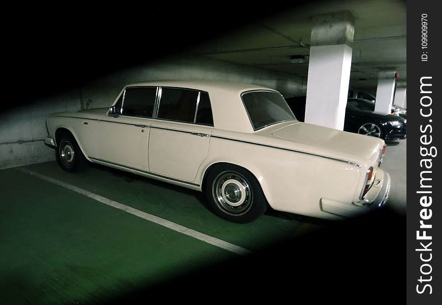 Photography of Vintage Car Parked on a Parking Lot