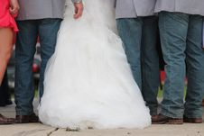 Free Three Men Wearing Gray Dress Shirt And Blue Denim Pants Between Woman In White Wedding Gown Royalty Free Stock Photo - 109910015