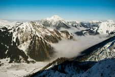 Free Rocky Mountain With Fog In Daytime Photo Stock Image - 109910061