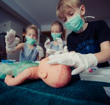 Free Three Children Playing Operation Toy Stock Images - 109910074