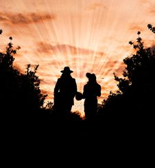 Free Silhouette Photo Of Man And Woman Wearing Hat Standing Between Trees During Golden Hour Royalty Free Stock Photography - 109910107