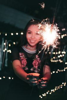 Free Woman Holding Firecrackers Stock Images - 109910224