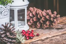 Free Brown Pinecone Beside Candle Lantern Stock Images - 109910314