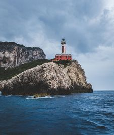 Free Red Lighthouse On Top Of Hills Beside Sea Royalty Free Stock Image - 109910336