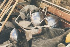 Free Two Gray Stainless Steel Soldier Helmet On Brown Wooden Bench Royalty Free Stock Images - 109910359
