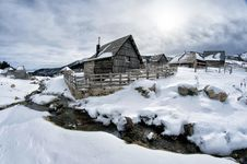 Free Black Wooden House Surrounded By Snow Under White Clouds Stock Images - 109910424
