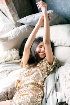 Free Woman Wearing Brown Sequin Dress Laying On The Bed Stock Image - 109910461