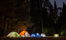 Free Six Camping Tents In Forest Stock Photos - 109910503