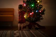 Free Girl In Red And Black Dress Standing In Front Of Christmas Tree Inside Room Stock Images - 109910704