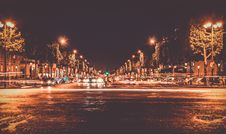 Free Lighted Street With Cars Passing By During Nighttime Royalty Free Stock Photos - 109910728