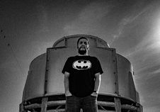 Free Man In Batman Print Shirt Stand Against Container Stock Photography - 109910892