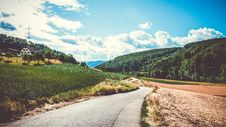 Free Green Field And Road In Landscape Photography Stock Images - 109911314