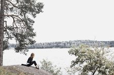 Free Woman Sitting On Gray Soil Near Body Of Water Royalty Free Stock Image - 109911426
