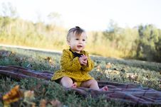 Free Baby Wearing Yellow Crochet Long Sleeve Dress Sitting On Brown Textile Stock Photos - 109911523