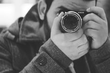 Free Man Taking Photo Using Black Dslr Camera Stock Photos - 109911573
