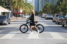 Free Woman In Black Long Sleeve Shirt Holding Bicycle Stock Photo - 109911650