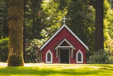 Free Red Chapel On Grassy Field With Trees Stock Photography - 109911812