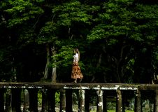 Free Woman Walking On Bridge Surrounded By Trees Royalty Free Stock Photo - 109911855