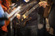 Free Man Holding Electric Bass Guitar Stock Photography - 109912022