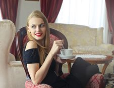 Free Woman In Black Cold-shoulder Dress Holding Tea Cup With Saucer Stock Photography - 109912032