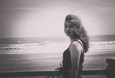 Free Grayscale Photo Of Woman Wearing Tank Top Standing Near Seashore Royalty Free Stock Photo - 109912035
