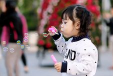 Free Toddler Girl Wearing White And Black Sweater Holding Plastic Bottle Of Bubbles At Daytime Stock Image - 109912051