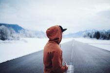 Free Man Wearing Brown Hoodie In Road Stock Image - 109912081