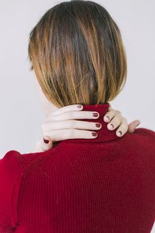 Free Woman In Red Turtle-neck Shirt Touching Her Neck Royalty Free Stock Images - 109912139