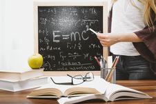 Free Woman Illustrating Albert Einstein Formula Stock Photo - 109912160