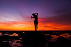 Free Silhouette Of Woman Standing On Rock Stock Image - 109912261