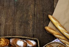 Free Stick Breads On Wooden Plank Stock Photos - 109912293