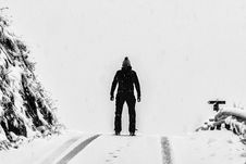 Free Man Standing On White Snow Covered Ground Beside Mountain Royalty Free Stock Photos - 109912378